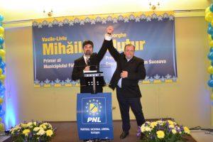 Candidatul PNL, Liviu Mihăilă, alături de Gheorghe Flutur